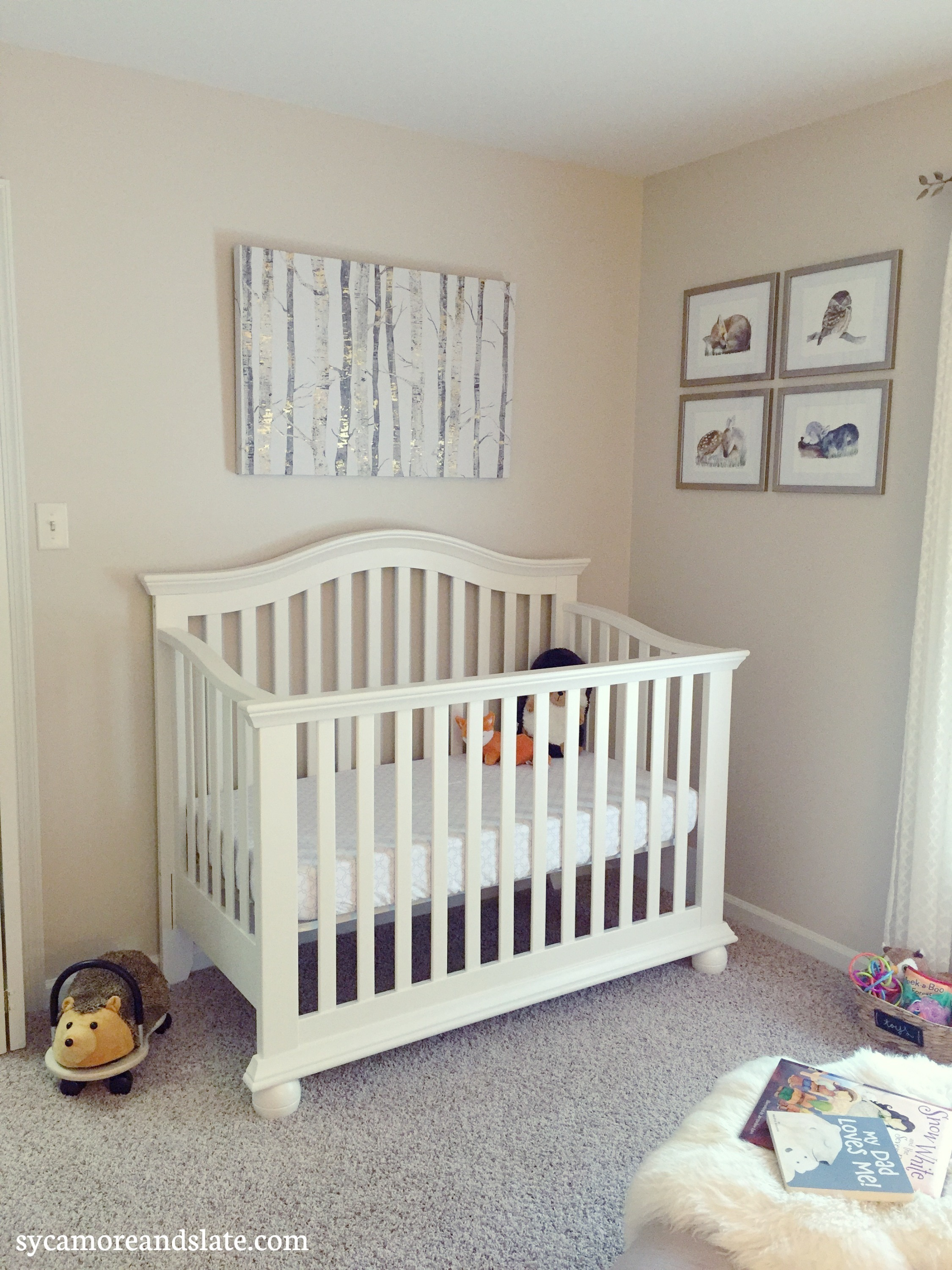 crib with wall art