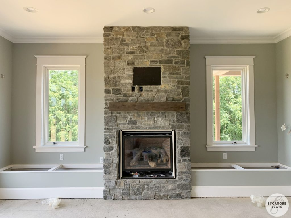 sun room fireplace with flanking window seats