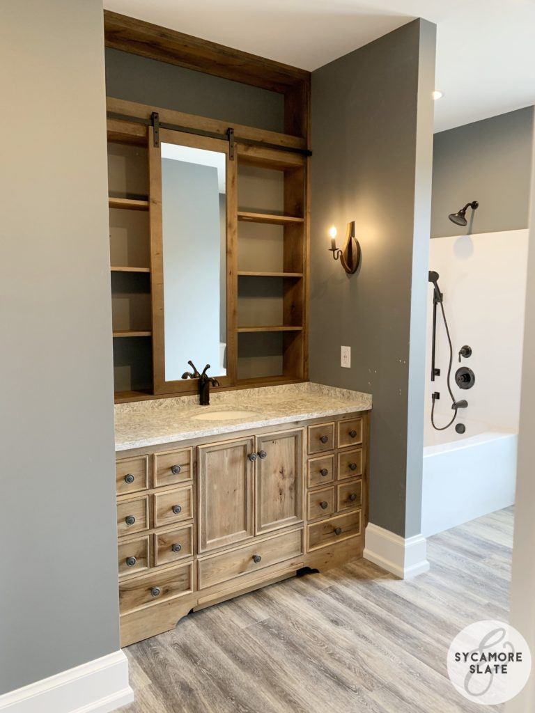 evie's vanity with sliding barn door mirror and bathtub