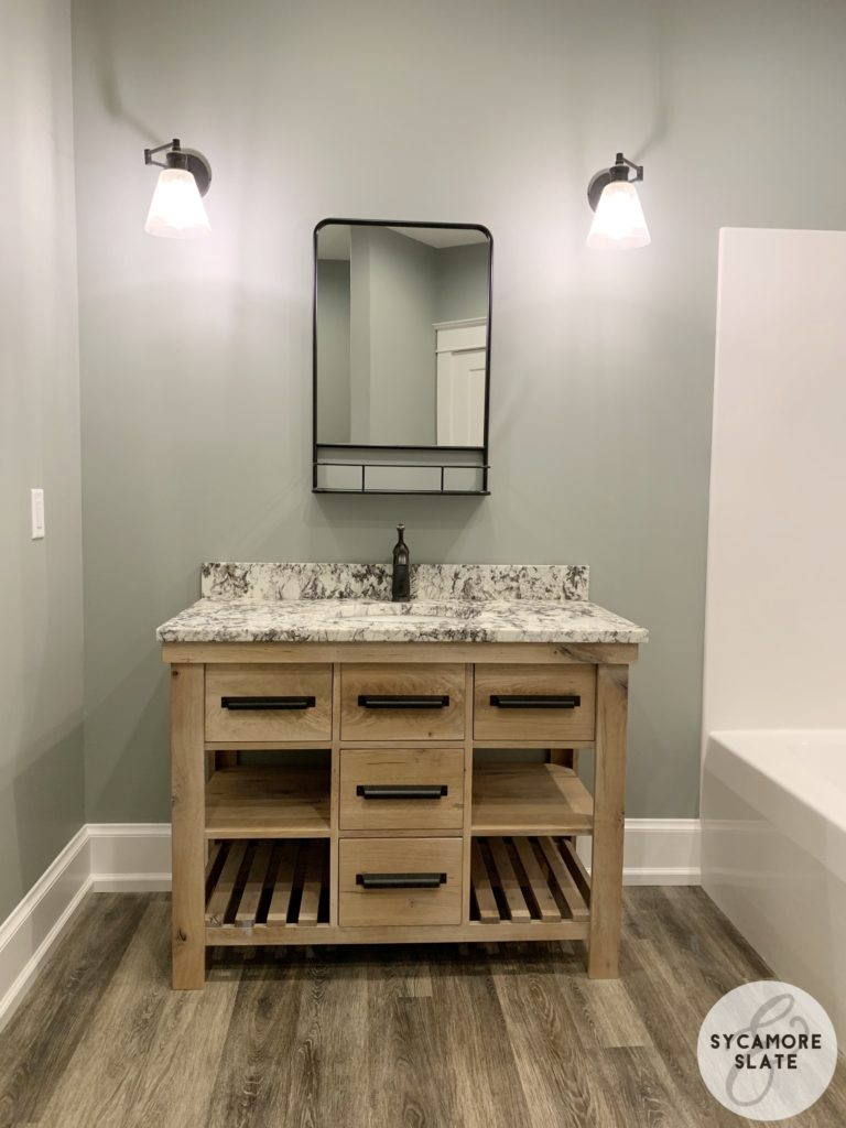 single wood farmhouse vanity with shelf / mirror above