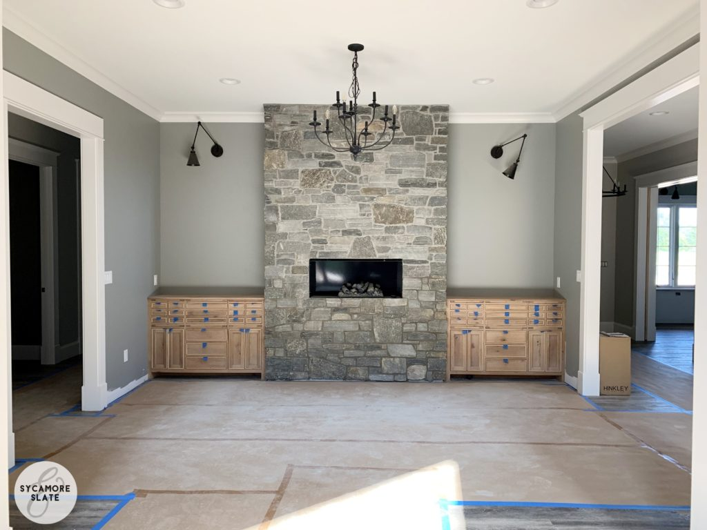 dining room fireplace with flanking buffet servers