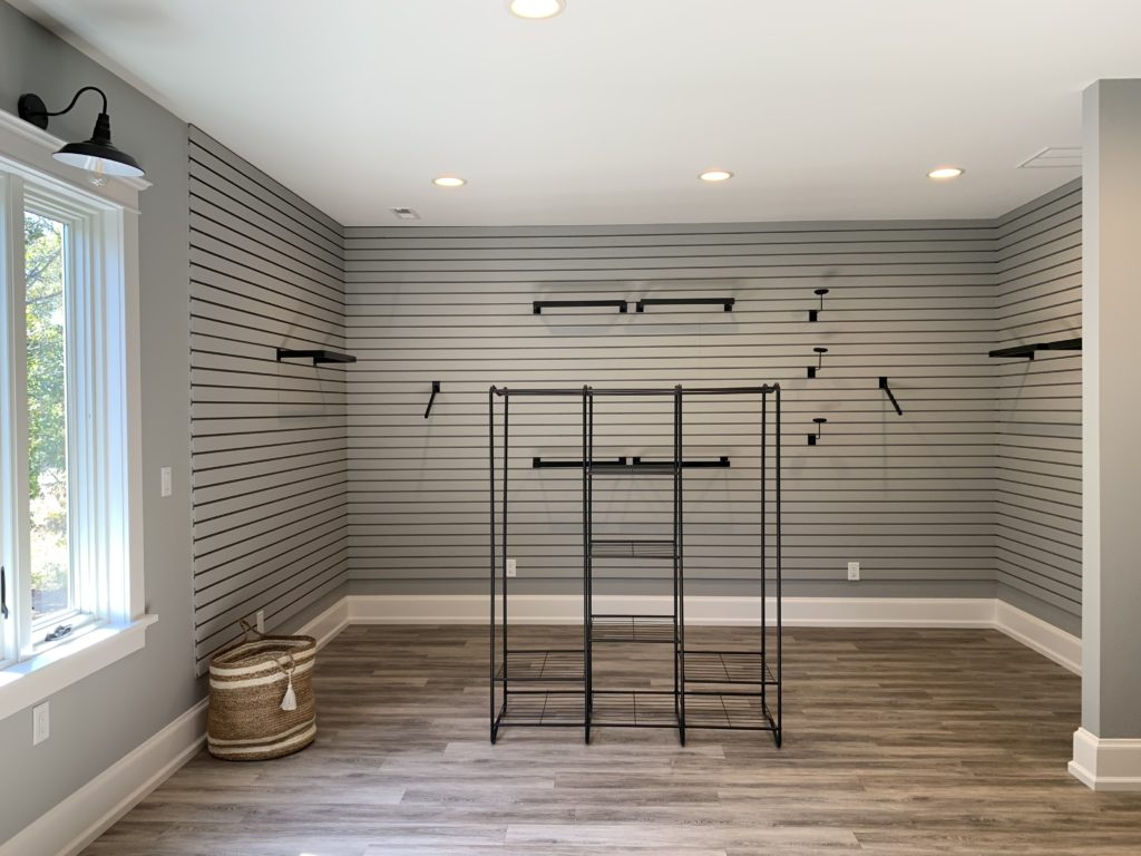 walk in master closet with slat wall
