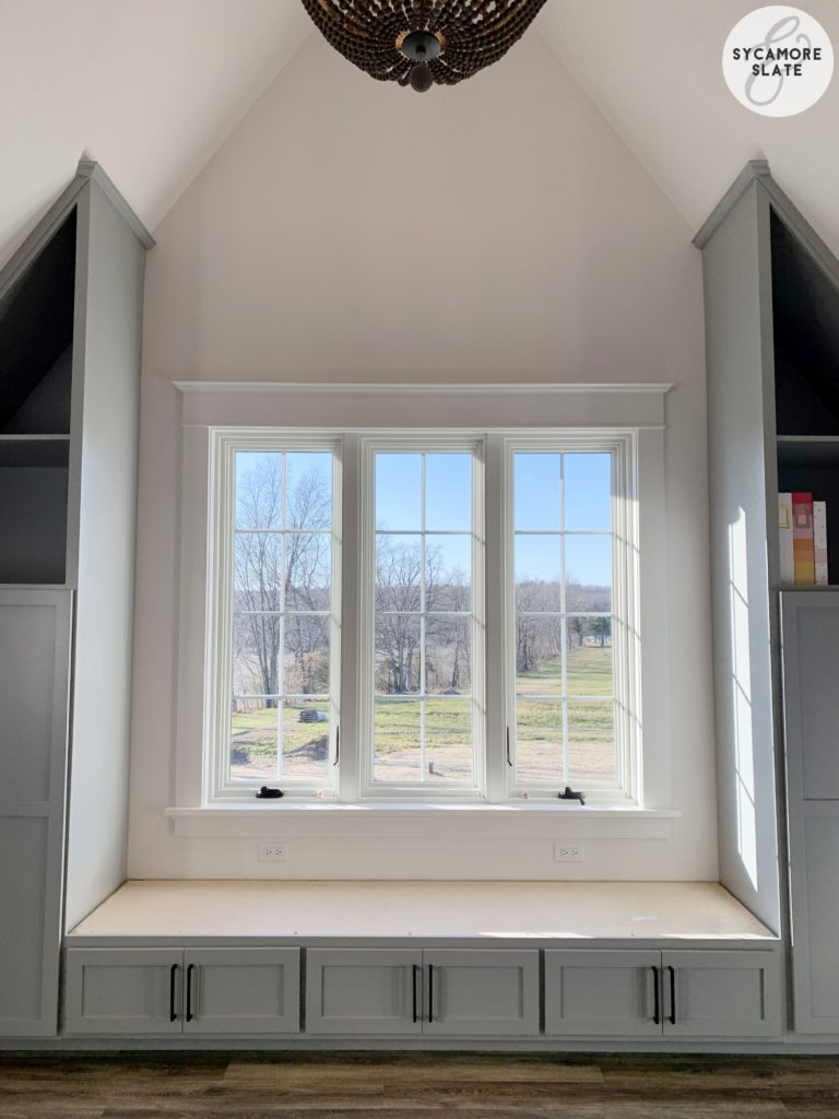 window seat in laundry room with storage